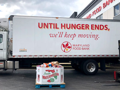 Maryland Food Bank truck and pallet of donated food.